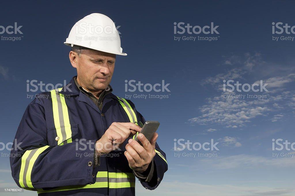 Auftragnehmer und Smartphone – Foto