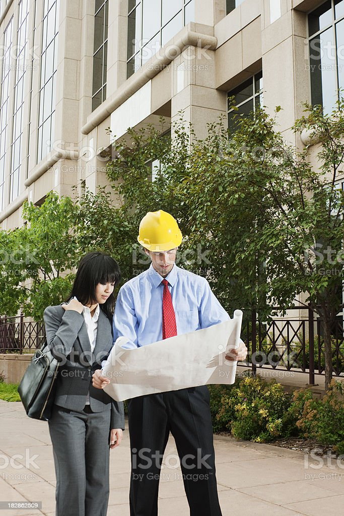 Contractor, Architect, Client or Business Partner Working with Construction Document royalty-free stock photo