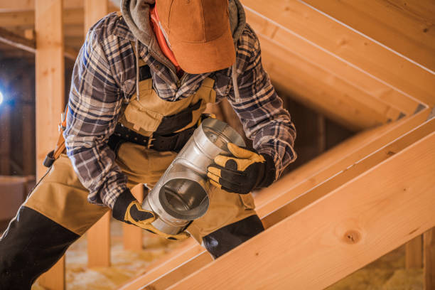 Contractor Assembling HVAC Pipes In Attic Of New House. stock photo