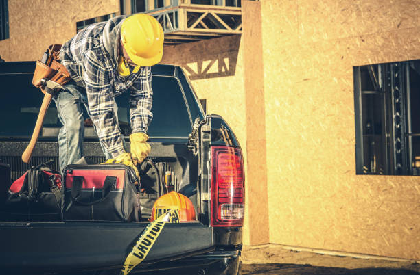 Contractor Cleaning His Pickup Cargo Bed stock photo