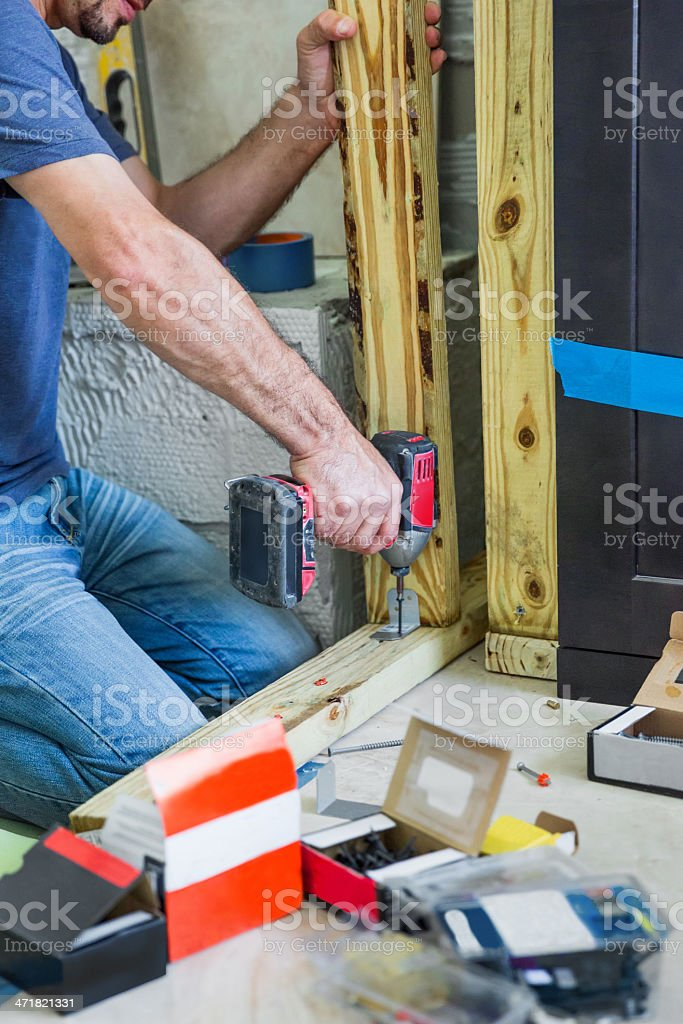 contractor drilling a screw into wood royalty-free stock photo
