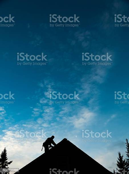 Contractor in silhouette working on a roof top picture id504102095?b=1&k=6&m=504102095&s=612x612&h=flduet2cnyqca3mpd1hlxyifohzvwqa0pk0g3czzkci=