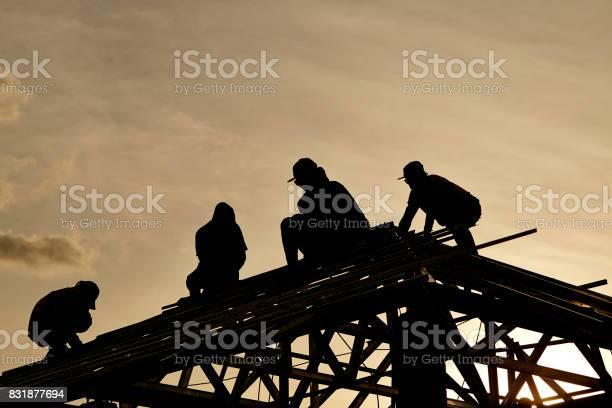 Contractor in silhouette working on a roof top picture id831877694?b=1&k=6&m=831877694&s=612x612&h=f6rnalspjcvyrp9iqttgchr0viyyuchbdkt2bmihvdq=