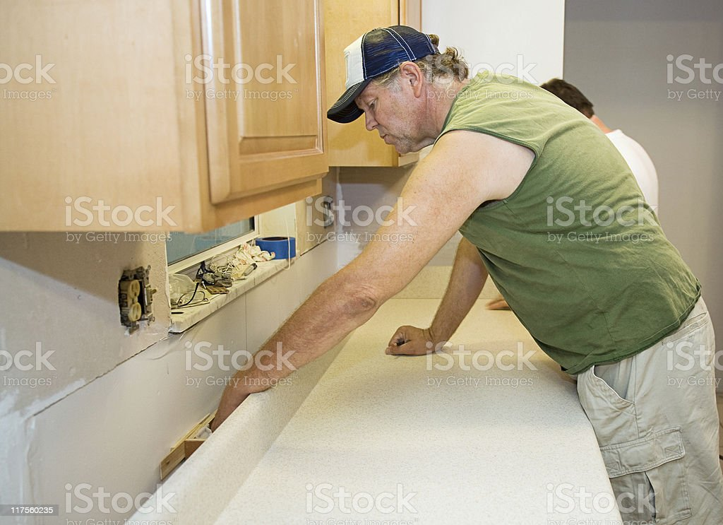 Contractor Installs Laminate Counter royalty-free stock photo