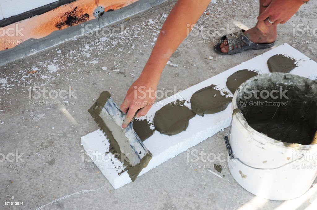 Contractor Insulation House Foundation with styrofoam insulation sheets. Wall insulation with foam board. Rigid Foam Insulation stock photo