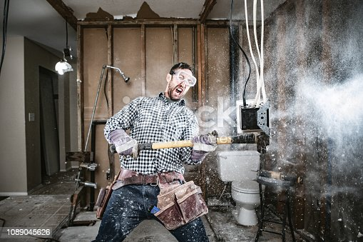 istock Contractor Man Doing Home Improvement and Demolition 1089045626