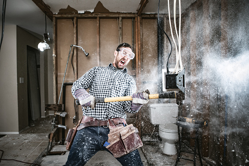 A man attempts to work on renovating his home, with funny and disastrous results.  He swings a sledgehammer, taking out part of a wall.