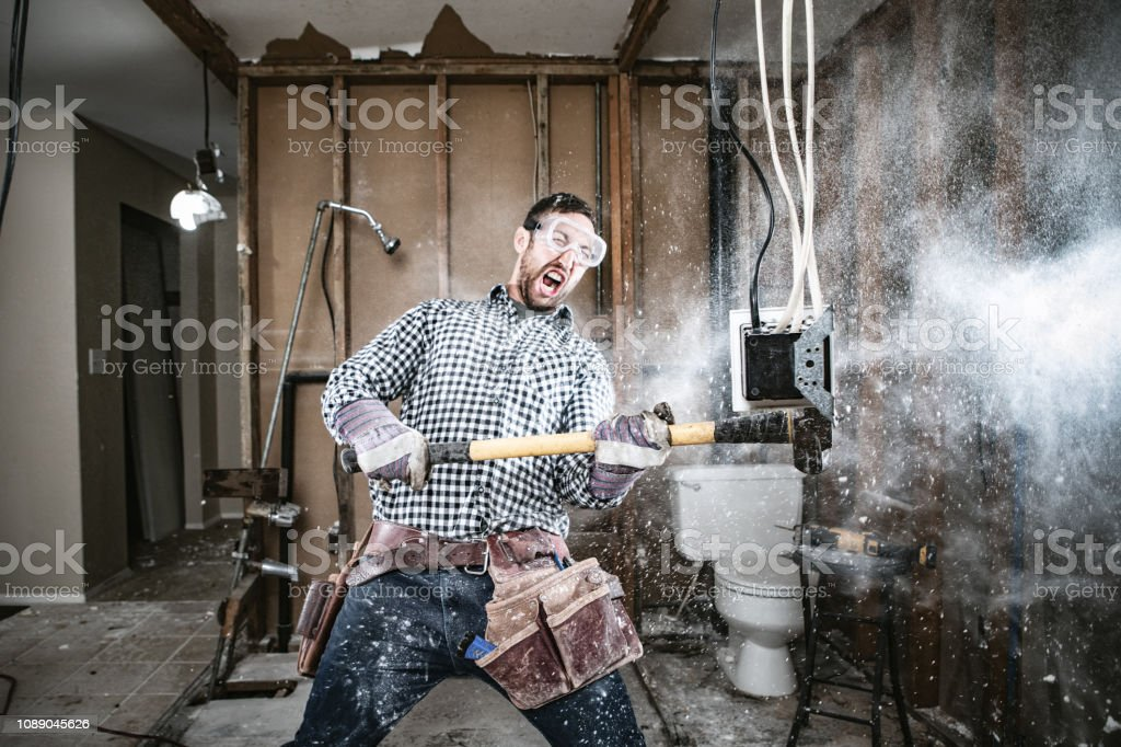 Contractor Man Doing Home Improvement and Demolition stock photo