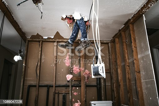 A man attempts to work on renovating his home, with funny and disastrous results.  He falls through the drywall ceiling feet first.