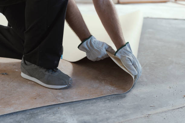 Contractor removing an old linoleum flooring Professional contractor removing an old linoleum flooring: home renovation concept linoleum stock pictures, royalty-free photos & images