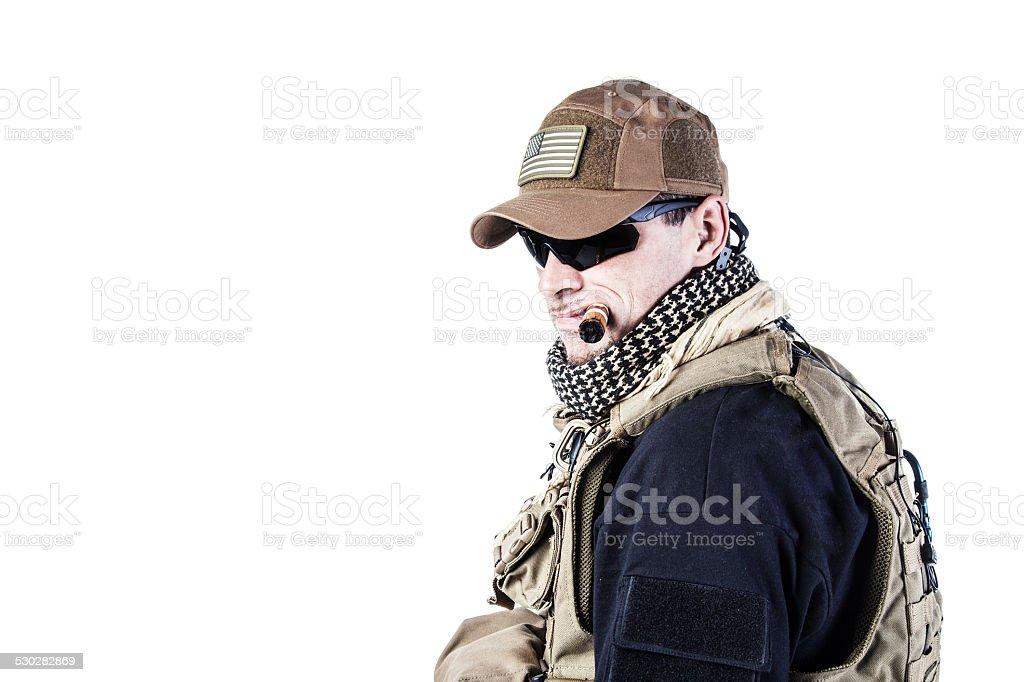 PMC contractor smoking a cigar stock photo
