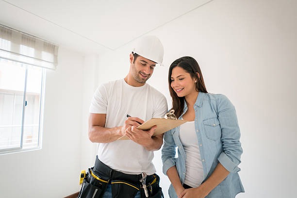 Contractor talking to a woman at home stock photo