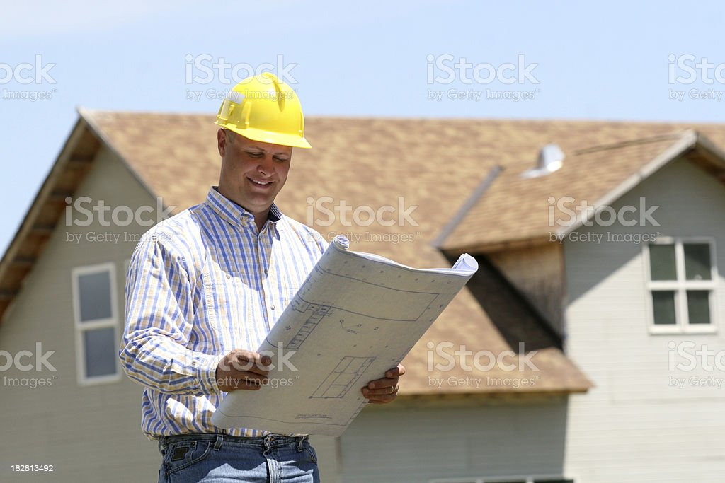 Contractor with house plans royalty-free stock photo