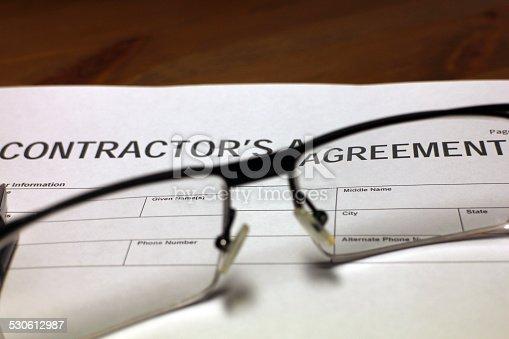 532257236istockphoto Contractor's Agreement Paperwork 530612987