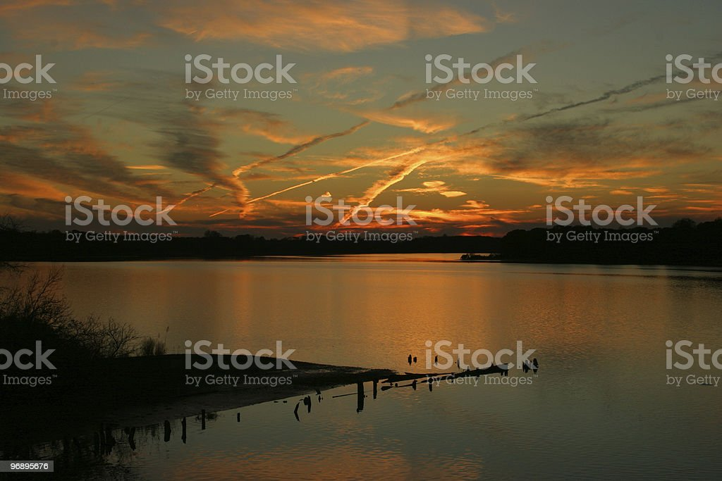Contrails at sunset #2 royalty-free stock photo