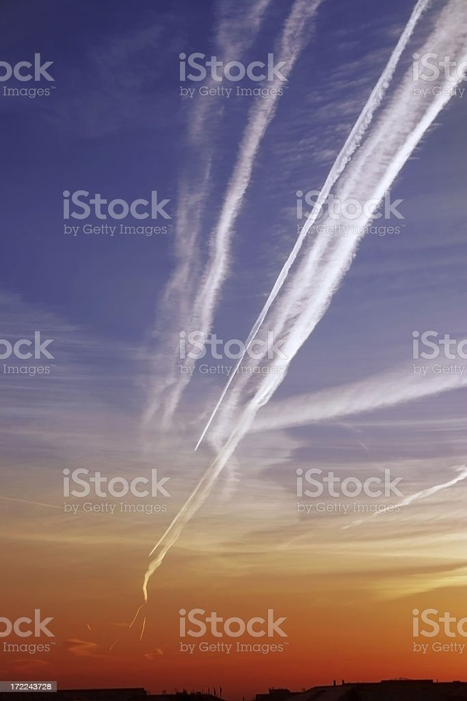 Contrails in the Sunrise stock photo