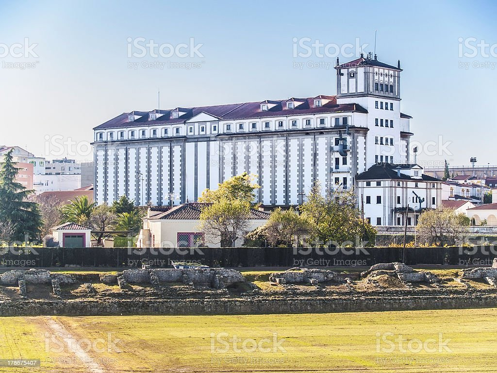 Contrast ancient Roman circus and factory building stock photo