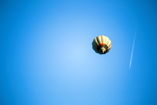 Contrast in technology- hot air ballon and airplane