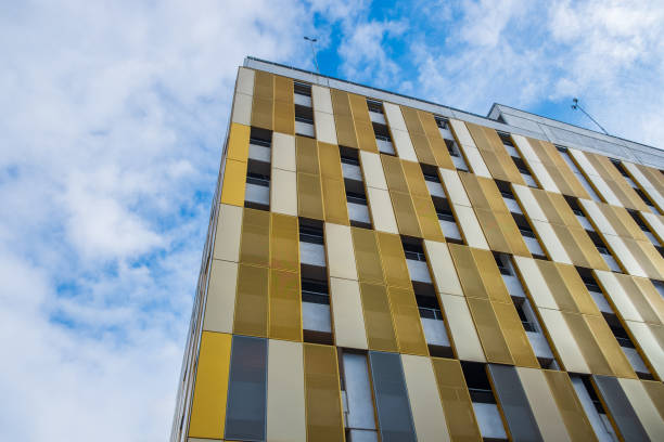 Contrasting colors and shapes on building facade against the sky in Manchester, UK stock photo