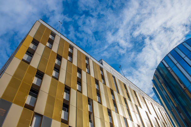 Contrasting colors and shapes on building facades against the sky in Manchester, UK stock photo