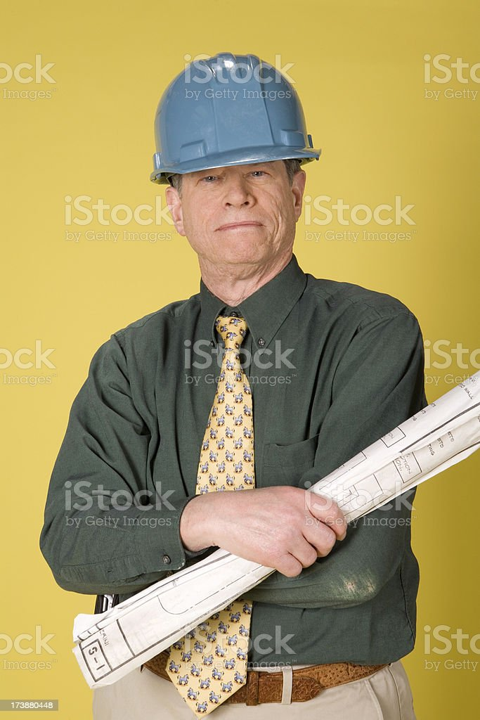 Contrator with plans royalty-free stock photo