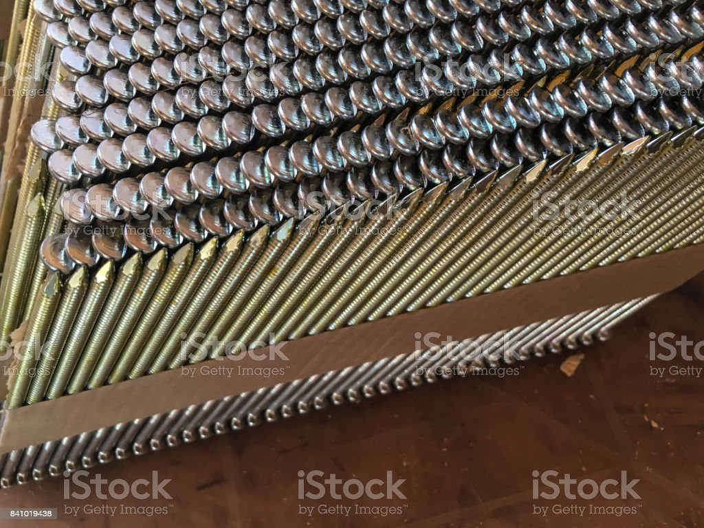 contributions of nails to the pneumatic handgun arranged by oneself stock photo