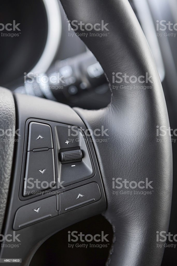 Control buttons on the steering wheel of a vehicle royalty-free stock photo