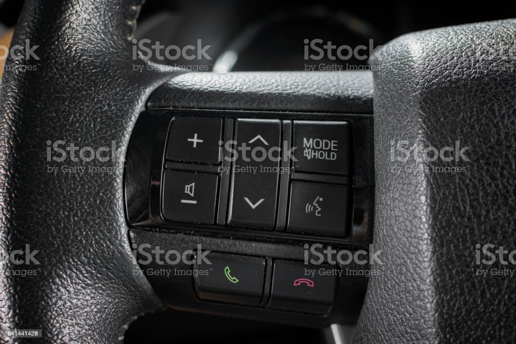 Control buttons on the vehicle steering wheel. stock photo