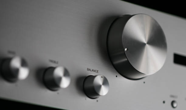 Control Knobs on a Silver Metallic Amplifier - Shallow Depth of Field stock photo