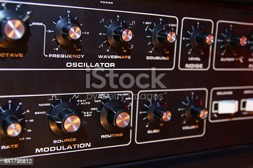 istock Control panel of a retro vintage electronic music synth 641795812