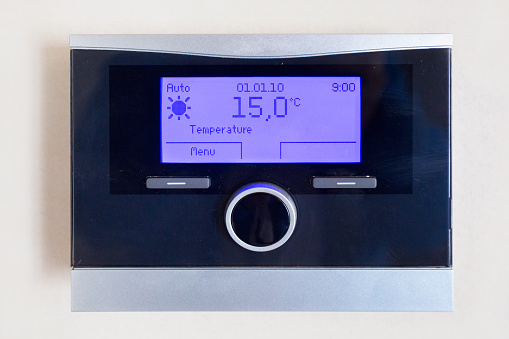 istock Control panel of central heating with temperature 980392684