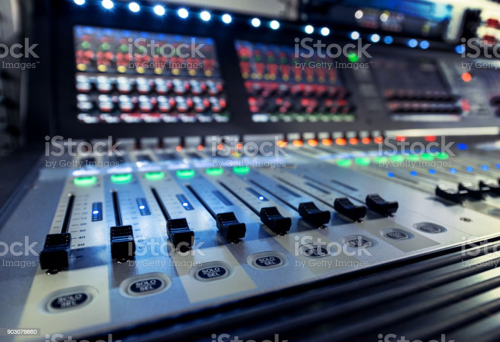 control panel of the sound engineer with the mixers on the television studio stock photo