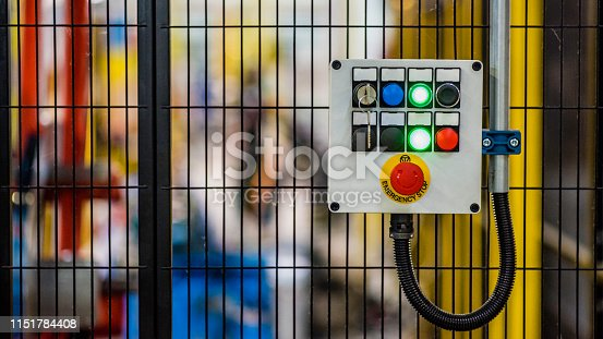 Control panel with push buttons on a factory metal mesh doors.