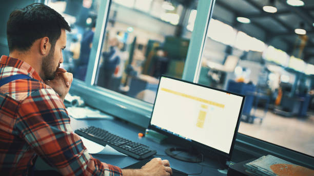 control room at a modern industrial production line. - computer aided manufacturing stock photos and pictures