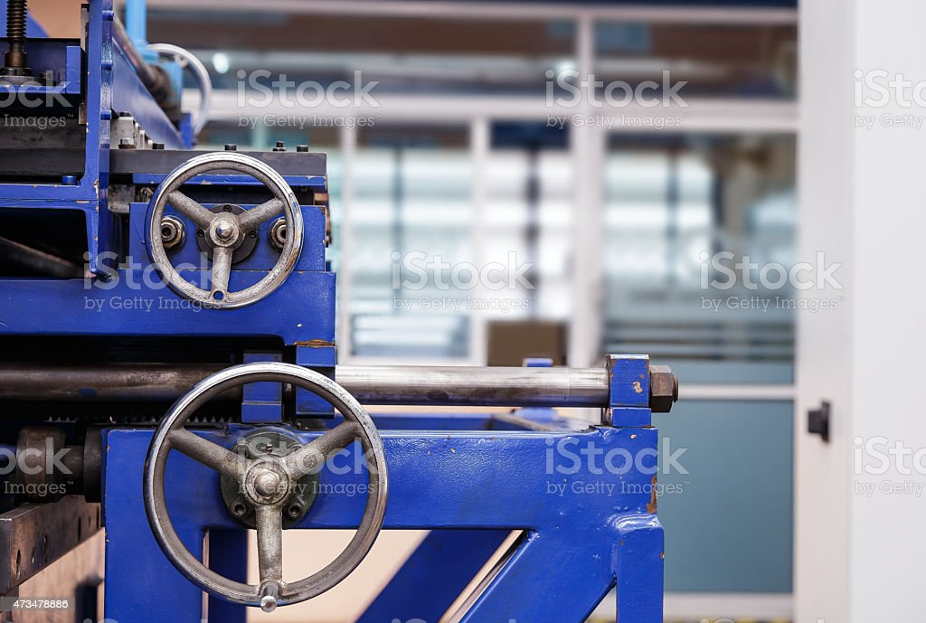 Control wheels of cutting machine stock photo
