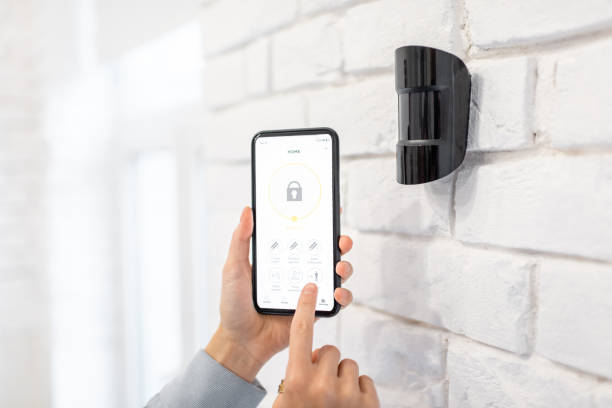 Controlling alarm system with a smart phone stock photo