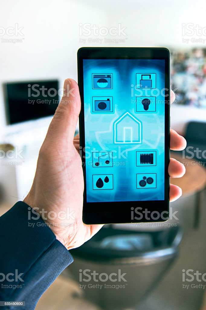 controlling internet of things in smart home with phone app stock photo more pictures of. Black Bedroom Furniture Sets. Home Design Ideas