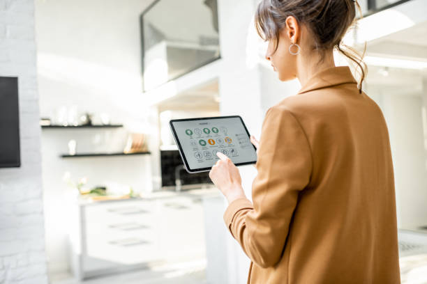 Controlling smart home with a digital tablet stock photo