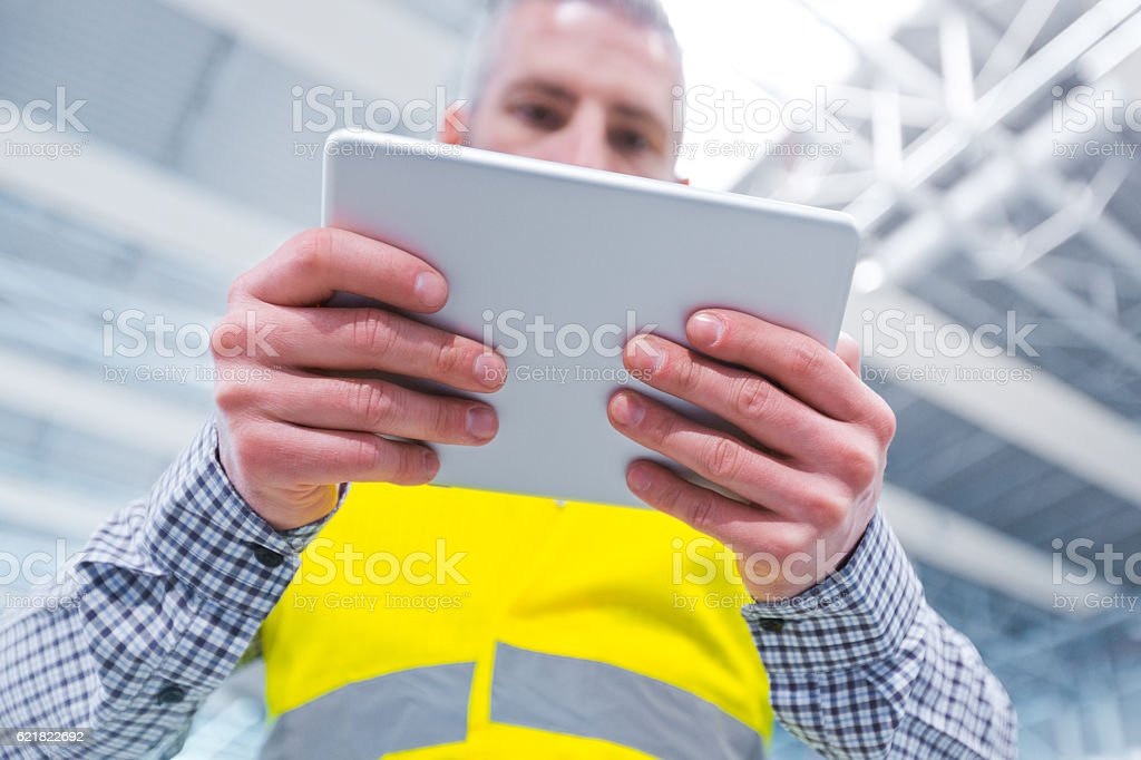 Contruction engineer using a digital tablet Contruction engineer using a digital tablet. Close up of hands. Adult Stock Photo