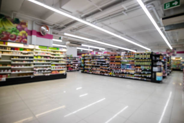Convenience store interior abstract blur background Convenience store interior abstract blur background snack aisle stock pictures, royalty-free photos & images