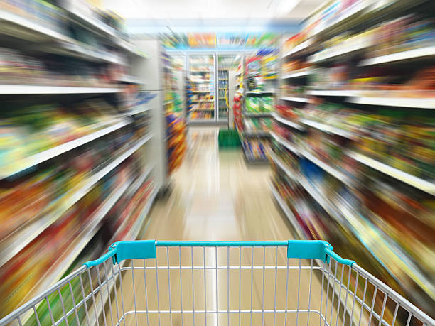 convenience store convenience store shelves with shopping cart, motion blur snack aisle stock pictures, royalty-free photos & images
