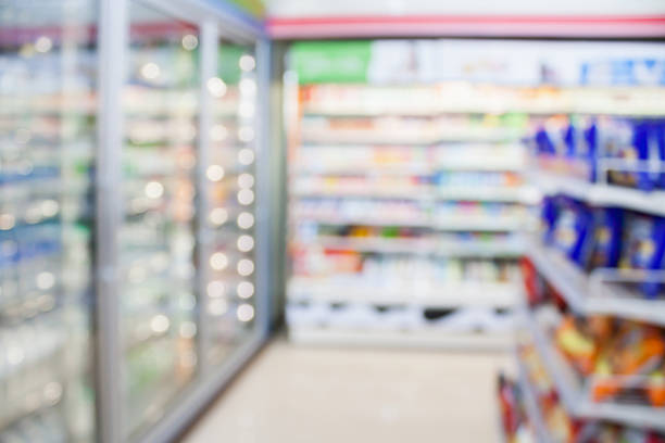 convenience store refrigerator shelves blurred background stock photo