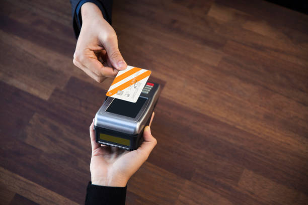 convenient way of payment - paying with card contactless imagens e fotografias de stock