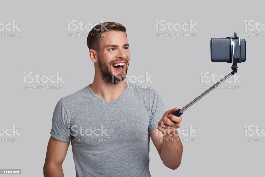 Convenient way to take selfie. stock photo