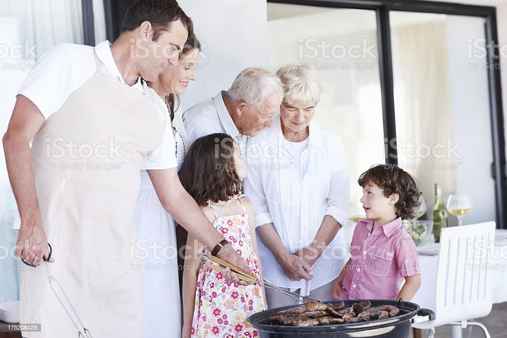 Conversation around the barbecue - Family Gathering royalty-free stock photo