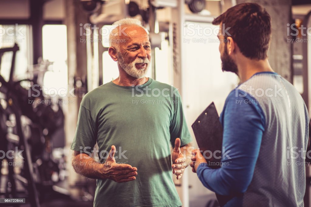 Conversation at gym. royalty-free stock photo