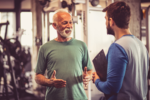 Conversation At Gym Stock Photo - Download Image Now