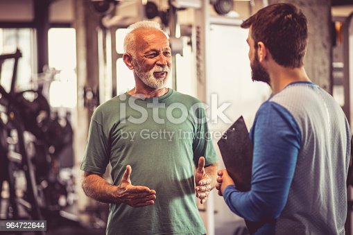 Conversation At Gym Stock Photo & More Pictures of Adult
