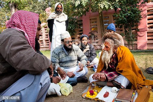 istock Conversation of the Muslim people with one hindu man 529140978