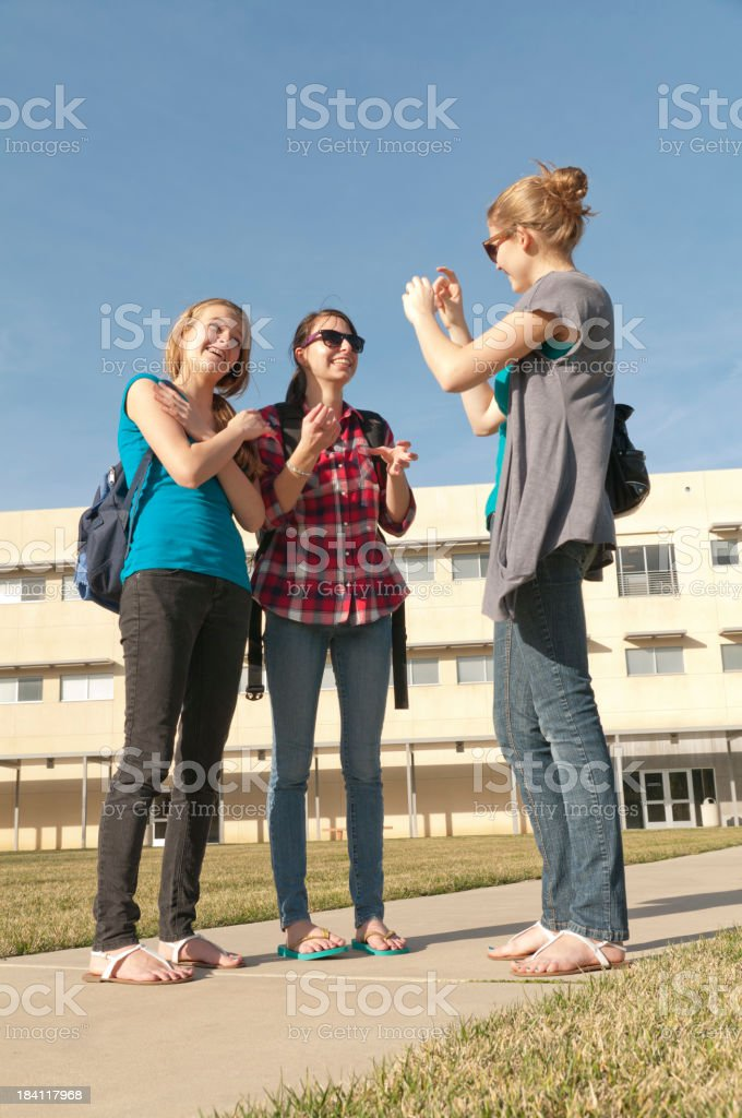 ASL conversation on school campus stock photo